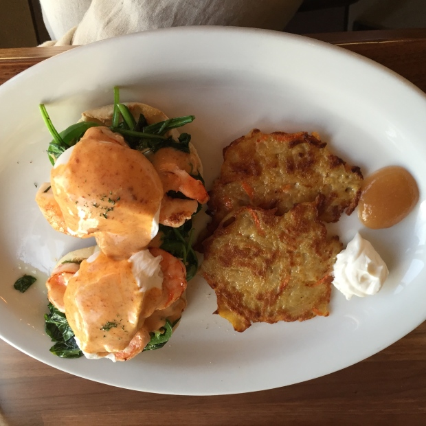 The Eggs Benedict served with carrot potato latkes